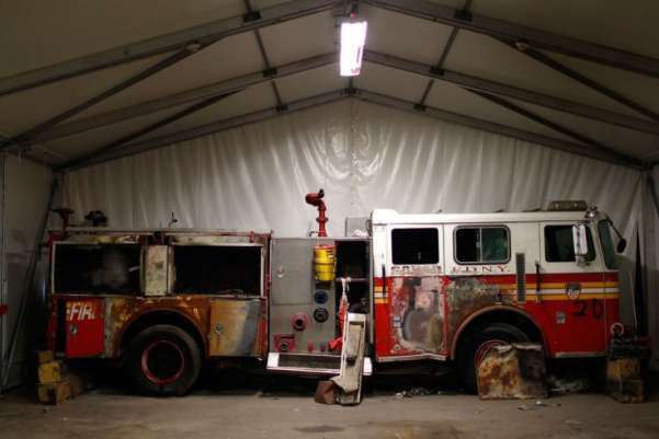 A fire truck recovered from the World Trade Center site after 9/11 sits inside an 80,000-sq.-ft. (7,500 sq m) hangar at JFK International Airport. The hangar holds artifacts to be displayed at the 9/11 Memorial in New York City. Curators from other museums can request from the hangar damaged steel from Ground Zero to display at their institutions. Mike Segar—Reuters
