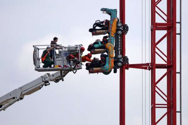 Firemen practice a rescue from a roller coaster in Leipzig. With the help of a telescopic hinge pole lift, rescue crews can now work at a height of 46 metres.Jan Woitas—DPA/Zuma Press