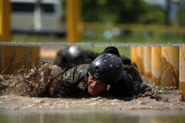 A Brazilian elite team member participates in the 2011 Commando Forces competition in San Salvador. 25 teams from countries of the hemisphere participate to prepare elite forces to fight terrorism and organized crime in Latin America. Jose Cabezas—AFP/Getty Images