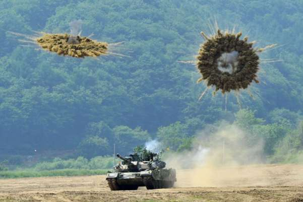 A South Korea's K1 tank fires smoke shells during a joint military drill between South Korea and the US in Paju near the inter-Korean border, aimed at deterring North Korea's military threat. Tensions on the Korea peninsula are high following two deadly border incidents last year which Seoul blames on its neighbor.Jung Yeon-Je—Getty Images