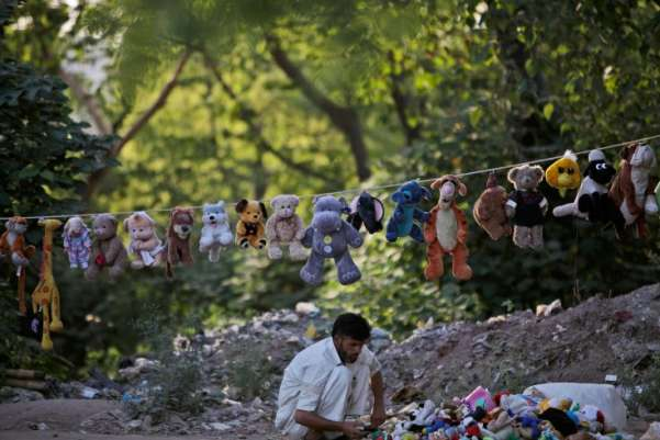 A Pakistani vendor displays his dolls on a roadside as he waits for customers on the outskirts of Islamabad, Pakistan.Muhammed Muheisen—AP