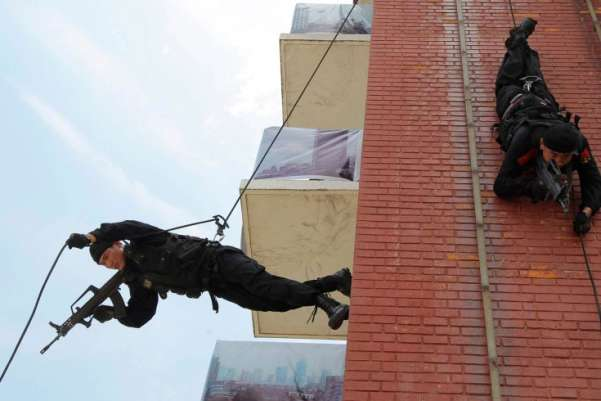 Paramilitary policemen rappel down a building as they take part in an anti-terrorism drill in Shanghai. China Daily/Reuters