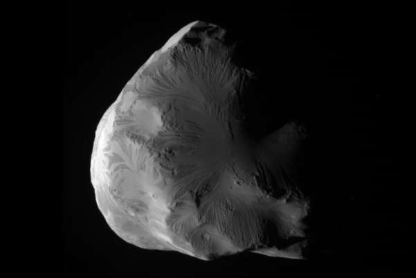 NASA captured this image of Helene, an icy and irregular moon of Saturn. At its closest approach, the NASA spacecraft Cassini flew within 4,330 miles (6,968 km) of Helene's surface. AFP/Getty images