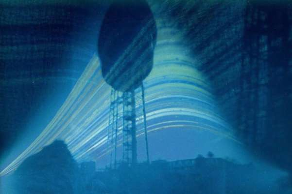 These weird pictures capturing the sun in the sky from the shortest to longest day of the year were shot with a home-made cameras made from a beer can. Around 100 pinhole cameras were put around an observatory in Holland last December as part of a public experiment, revealing the sun's progress after six months. Philippus Lansbergen Observatory/National News/Zuma Press
