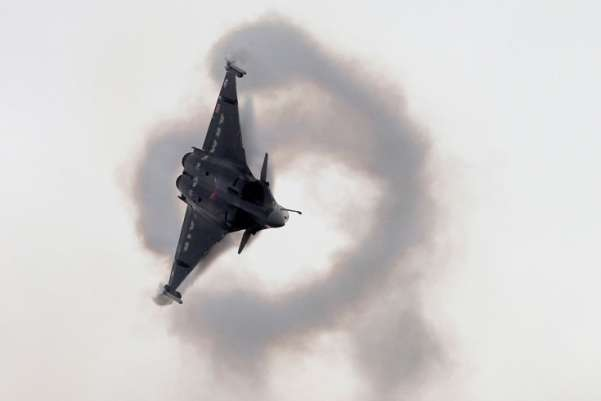 A French Rafale-2 jet fighter performs during its demonstration flight at the 49th Paris Air Show at le Bourget airport, east of Paris. Francois Mori—AP