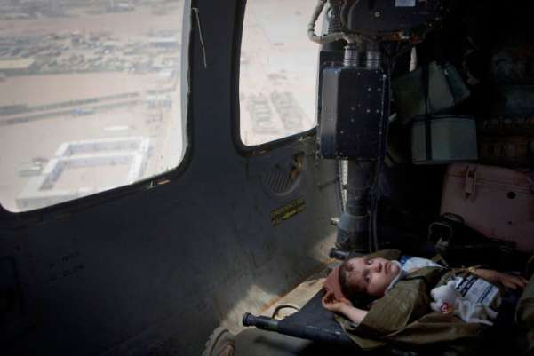 Persia, a 7-year-old Afghan, rests as she is flown on a U.S. Army medevac helicopter to a military hospital outside Sangin in southern Afghanistan. The girl received head injuries after falling off a truck; her father took her to the nearest NATO security outpost for medical help.Anja Niedringhaus—AP