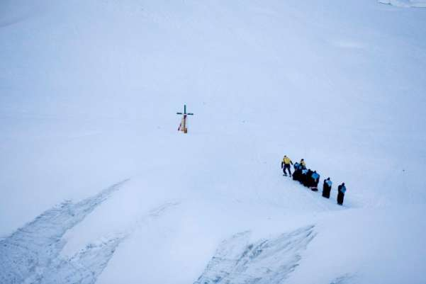 """Ukukus,"" or protectors of the Lord ""Qoyllur Rit'i,"" try to reach a cross on a glacier during celebrations in honor of the Lord at the Sinakara Valley in Cuzco, June 21, 2011. The annual festivity of the Lord of ""Qoyllur Rit'i"" or Lord of the Snow Star attracts thousands of pilgrims, dancers and musicians from surrounding regions with processions and dances around the sacred shrine. The main event is carried out by protectors called ""ukukus"", who climb glaciers over the Mount Colquepunku to bring back crosses representing the Lord. Enrique Castro-Mendivil—Reuters"