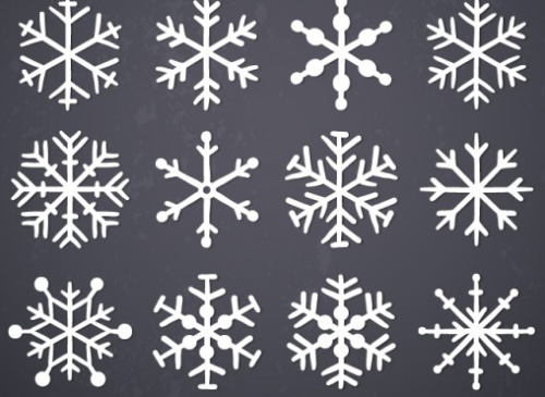 Hand drawn snowflakes on blackboard Free Vector