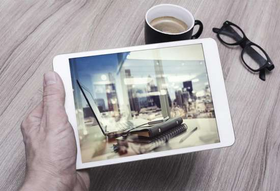 ipad_in_male_hand_mockup