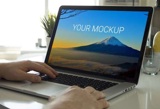working_on_macbook_mockup