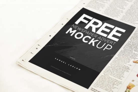 download_free_advertisement_newspaper_mockup