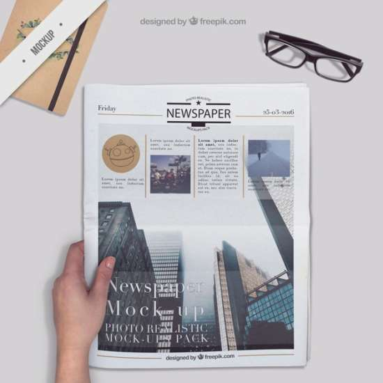 newspaper_on_a_desktop_with_agenda_and_glasses