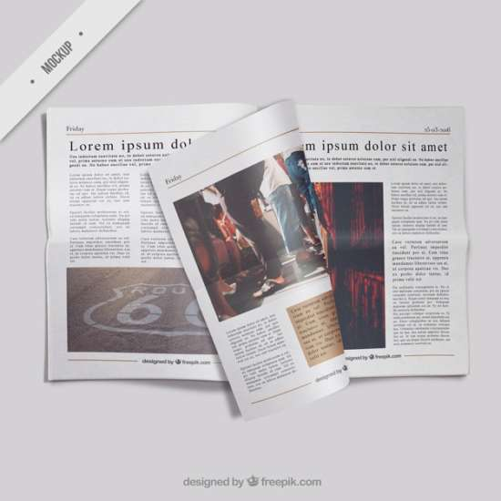 open_newspaper_mockup_with_a_folded_page
