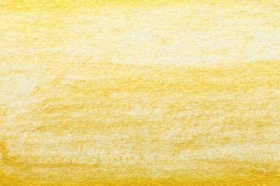 yellow_gold_abstract_watercolor_painting_textured_on_white_paper_background