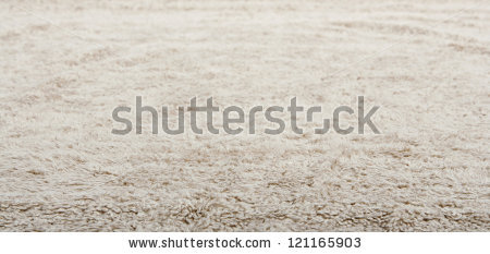 low_close_up_view_of_a_beige_furry_carpet_texture_background_full_frame