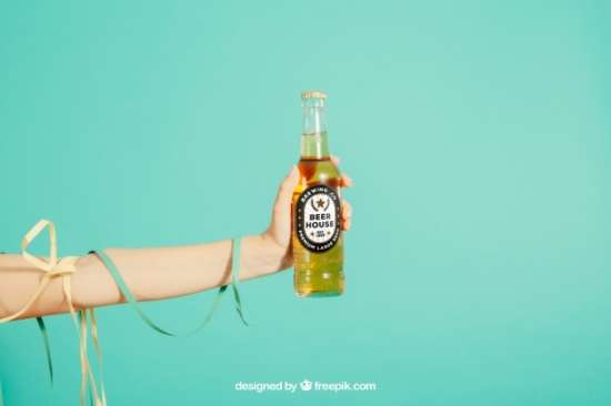 party_concept_with_arm_holding_beer_bottle